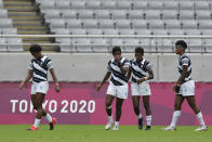 Fiji players walk on the pitch after losing to New Zealand in extra time in their women's rugby sevens semifinal match at the 2020 Summer Olympics, Saturday, July 31, 2021 in Tokyo, Japan. (AP Photo/Shuji Kajiyama)