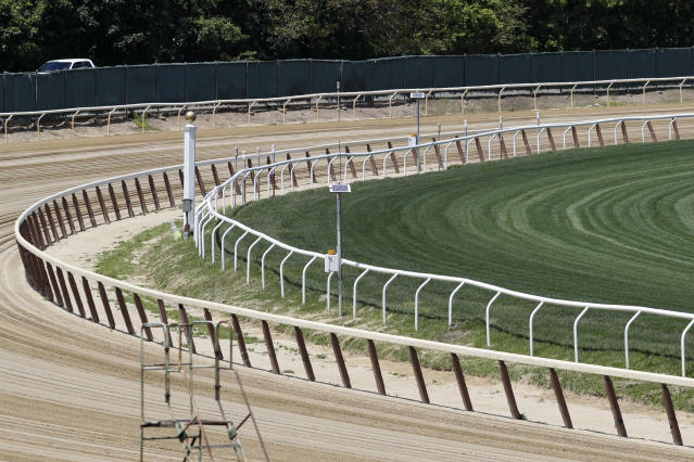 The far turn at Belmont Race Track is empty of action, Wednesday, May 27, 2020, in Elmont, N.Y. The track is the site of the Belmont Stakes race, usually the third leg of horse racing's Triple Crown. This year, however, due to concerns over the spread of the coronavirus, the race will be held as the first leg of the Triple Crown, and no spectators will be allowed. The race was rescheduled from early June to June 20, 2020. (AP Photo/Kathy Willens)