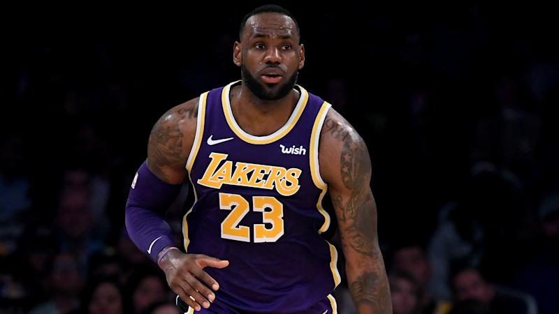 Kings snap Boston's 10-game win streak, James powers Lakers past Hawks