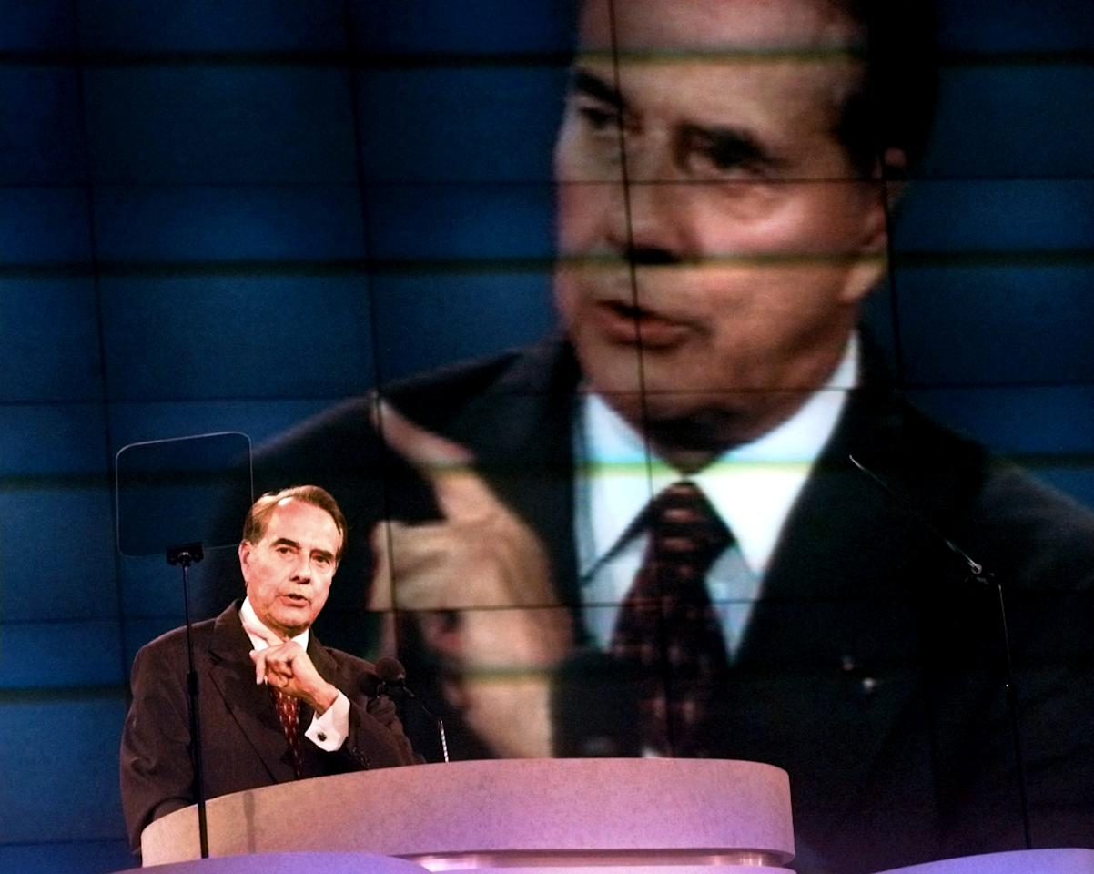 FILE - In this Aug. 15, 1996 file photo, Republican presidential nominee Bob Dole delivers his acceptance speech during the Republican National Convention in San Diego. Mitt Romney did not mention the war in Afghanistan, where 79,000 US troops are fighting, in his speech accepting the Republican presidential nomination on Thursday. The last time a Republican presidential nominee did not address war was 1952, when Dwight Eisenhower spoke generally about American power and spreading freedom around the world but did not explicitly mention armed conflict. Below are examples of how other Republican nominees have addressed the issue over the years, both in peacetime and in war. (AP Photo/Marta Lavandier, File)