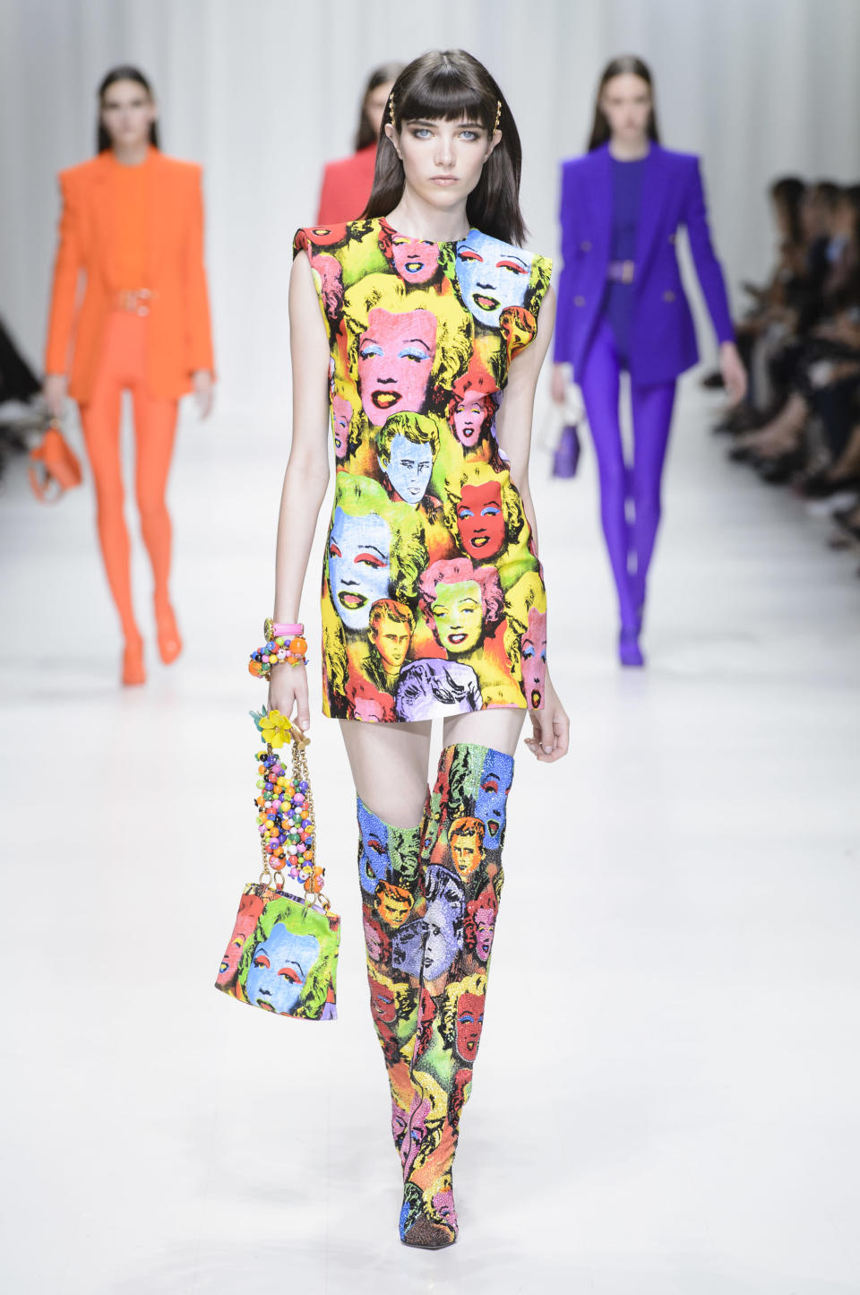 <p><i>Model wears a dress with matching bags and shoes printed with the famous Andy Warhol artwork of Marilyn Monroe from the SS18 Versace collection. This looks is an ode to when Gianni Versace first introduced the Warholian looks in 1993. (Photo: ImaxTree) </i></p>