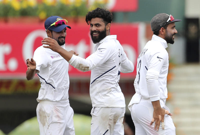 India's Ravindra Jadeja, center, celebrates with teammates the dismissal of South Africa's Zubayr Hamza during the third day of third and last cricket test match between India and South Africa in Ranchi, India, Monday, Oct. 21, 2019. (AP Photo/Aijaz Rahi)