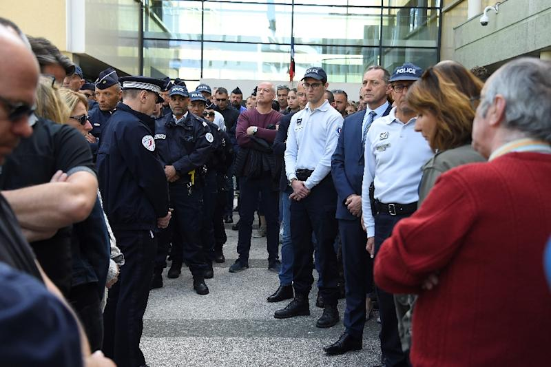 Policemen gathered at the main police station in the southern city of Montpellier to pay tribute to a colleague who committed suicide with her service weapon -- the latest of 28 French police officers who have taken their lives this year (AFP Photo/SYLVAIN THOMAS)