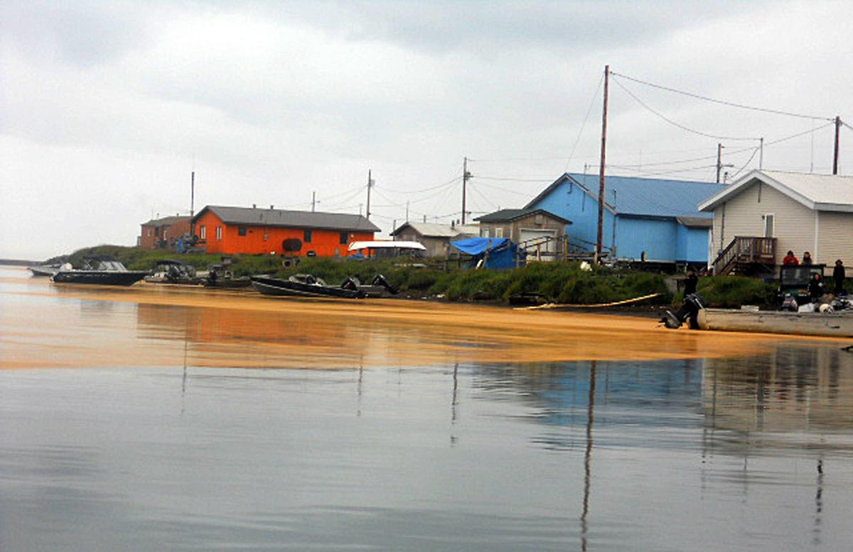 This Wednesday, Aug. 3, 2011 photo provided by the City of Kivalina, Alaska, shows an orange substance on the water surface in Kivalina, Alaska. City Administrator Janet Mitchell said the village is requesting that an algae expert from the University of Alaska Fairbanks investigate. (AP Photo/City of Kivalina)