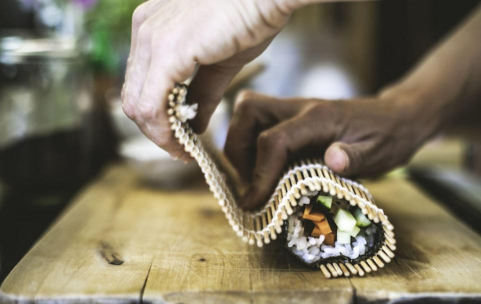 """<p>Craft the perfect (well, perfect to <em>you</em>) rolls from the comfort of your home. You just need sticky rice, nori, a sushi mat, and whatever fillings you desire to get to work.</p><p><a class=""""link rapid-noclick-resp"""" href=""""https://www.amazon.com/BambooMN-Natural-Rolling-Spreader-Utensils/dp/B074SVD5WG/?tag=syn-yahoo-20&ascsubtag=%5Bartid%7C10050.g.30445302%5Bsrc%7Cyahoo-us"""" rel=""""nofollow noopener"""" target=""""_blank"""" data-ylk=""""slk:SHOP SUSHI MAKING KITS"""">SHOP SUSHI MAKING KITS</a> </p>"""