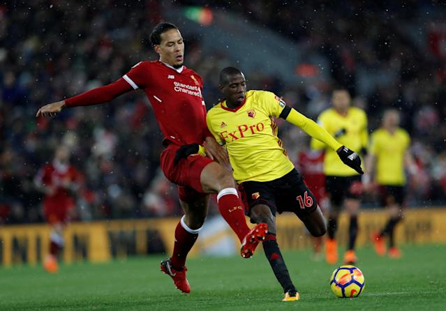"Soccer Football - Premier League - Liverpool vs Watford - Anfield, Liverpool, Britain - March 17, 2018 Watford's Abdoulaye Doucoure in action with Liverpool's Virgil van Dijk Action Images via Reuters/Lee Smith EDITORIAL USE ONLY. No use with unauthorized audio, video, data, fixture lists, club/league logos or ""live"" services. Online in-match use limited to 75 images, no video emulation. No use in betting, games or single club/league/player publications. Please contact your account representative for further details."
