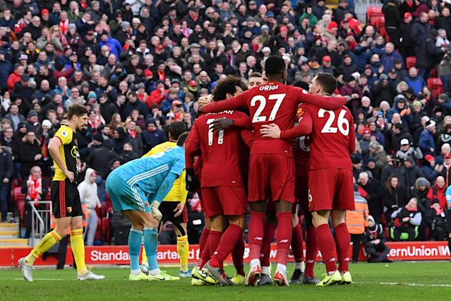 Liverpool's Egyptian midfielder Mohamed Salah celebrates with teammates. (Credit: Getty Images)