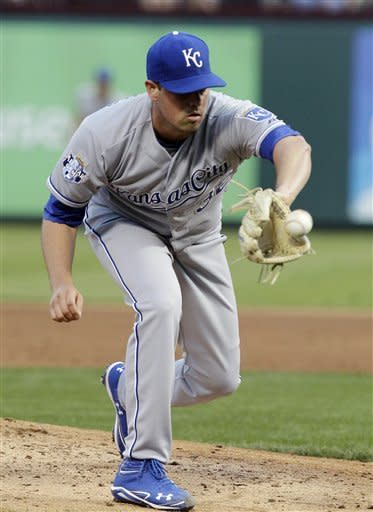 Kansas City Royals starting pitcher Vin Mazzaro (32) fields the ball against Texas Rangers' Alberto Gonzalez, not shown, before throwing to first for the out during the second inning of a baseball game, Tuesday, May 15, 2012, in Arlington, Texas. (AP Photo/LM Otero)