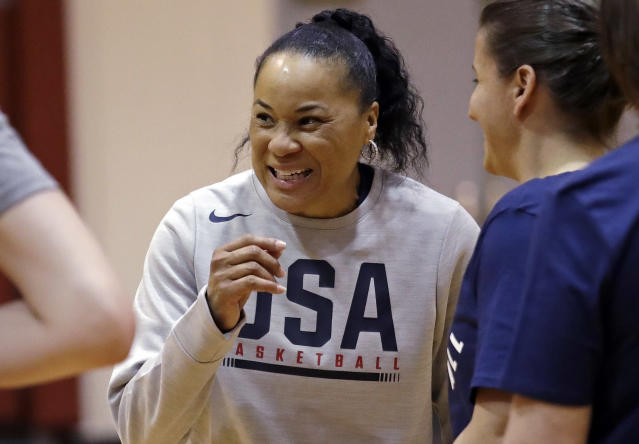FILE - In this April 24, 2018, file photo, coach Dawn Staley talks with players and assistant coaches during a practice for the U.S. women's basketball team in Seattle. Staley would be prepping the U.S. womens basketball team for the Tokyo Olympics this week if not for the coronavirus pandemic. Instead, shell hold a Zoom conference call with players who are vying for a spot on the roster in 2021, if the postponed Olympics are held next year. (AP Photo/Elaine Thompson, File)