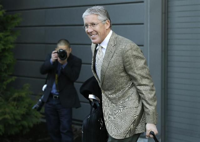 Seattle Seahawks head coach Pete Carroll leaves team headquarters in Renton, Wash., Sunday, Jan. 26, 2014, to board a bus for his flight to play the Denver Broncos in the NFL Super Bowl XLVIII football game in East Rutherford, N.J. (AP Photo/Ted S. Warren)