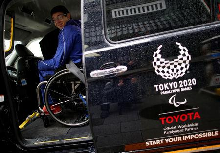 Paralympian Daniel Romanchuk of the U.S. rides in a Toyota Motor Corp.'s JPN Taxi during his tour of Tokyo, Japan March 4, 2019.   REUTERS/Issei Kato