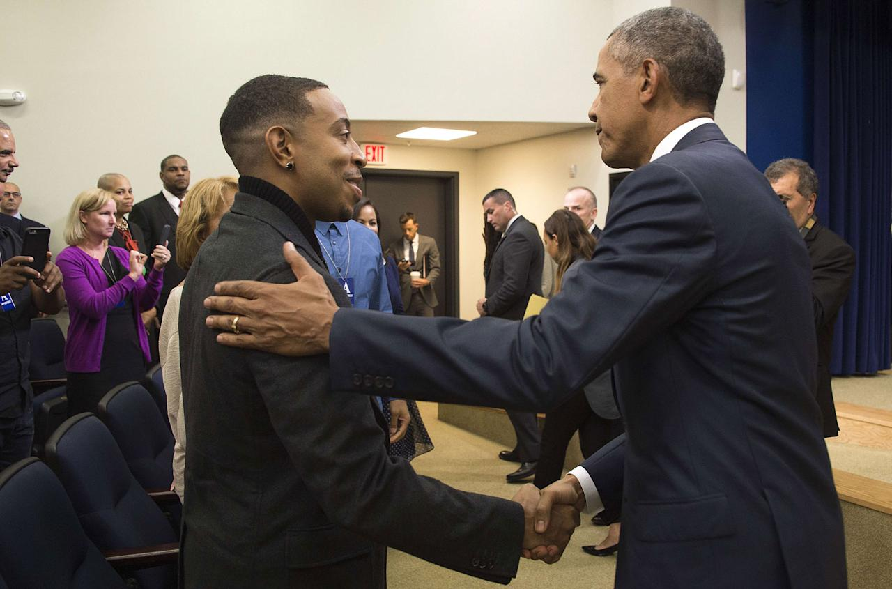 <p>Obama shakes hands with Ludacris after delivering remarks to criminal justice activists in Washington, D.C., in September 2015.</p>