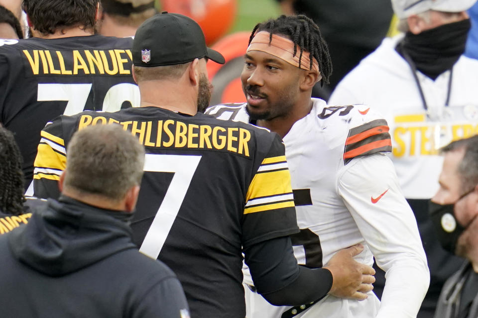 Myles Garrett was friendly with the Steelers a year after he swung his helmet at QB Mason Rudolph and started a brawl. (AP Photo/Gene J. Puskar)