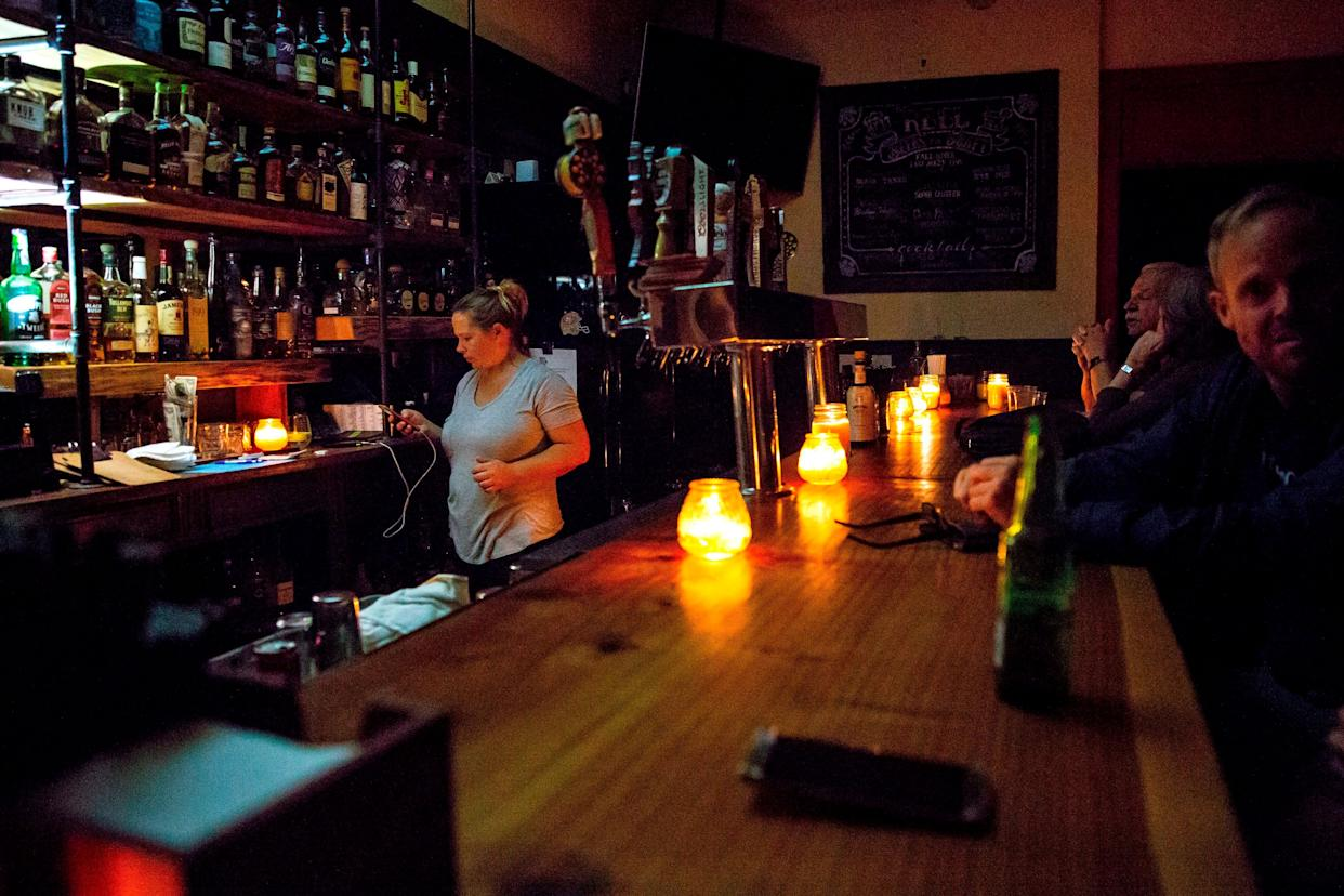 A candle-lit bar in Sonoma, California, amid a wide power outage that is expected to last several days. (Photo: BRITTANY HOSEA-SMALL via Getty Images)