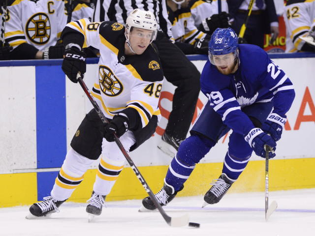 Boston Bruins defenseman Matt Grzelcyk (48) carries the puck past Toronto Maple Leafs right wing William Nylander (29) during the first period of an NHL hockey game, Saturday, Jan. 12, 2019 in Toronto. (Frank Gunn/The Canadian Press via AP)