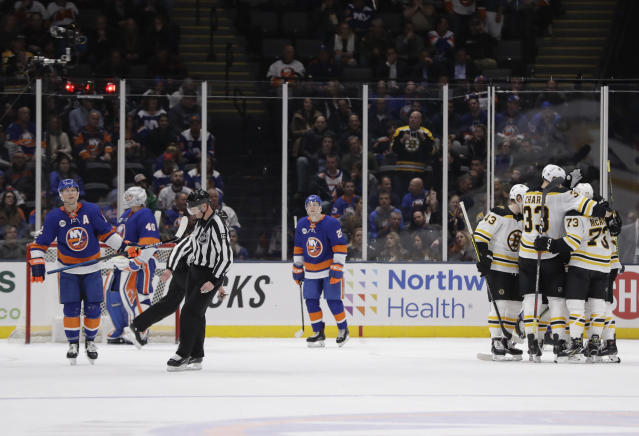 The Boston Bruins celebrate after Boston Bruins' Sean Kuraly scored a goal during the second period of an NHL hockey game against the New York Islanders Tuesday, March 19, 2019, in Uniondale, N.Y. (AP Photo/Frank Franklin II)