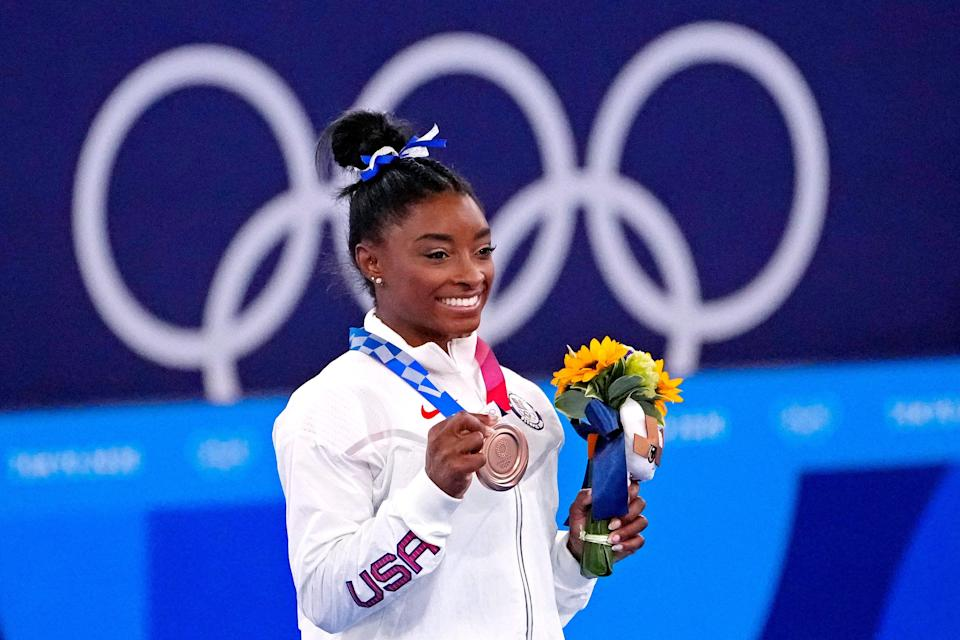 Simone Biles receives her bronze medal for balance beam on Tuesday at the Tokyo Olympics.