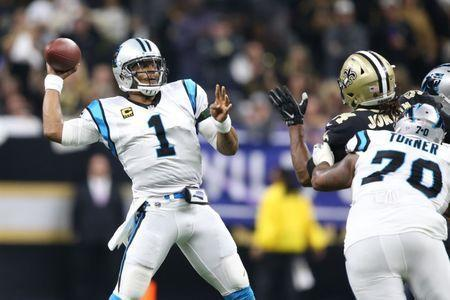 Jan 7, 2018; New Orleans, LA, USA; Carolina Panthers quarterback Cam Newton (1) drops back to pass against the New Orleans Saints during the first quarter in the NFC Wild Card playoff football game at Mercedes-Benz Superdome. Mandatory Credit: Chuck Cook-USA TODAY Sports