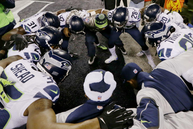 The Seattle Seahawks huddle before the NFL Super Bowl XLVIII football game against the Denver Broncos Sunday, Feb. 2, 2014, in East Rutherford, N.J. (AP Photo/Julio Cortez)