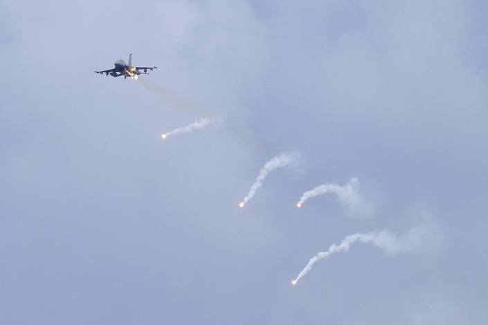 A U.S.-made F-16V fighter jet launches flares during the 36th Han Kung military exercises in Taichung City, central Taiwan, Thursday, July 16, 2020. Taiwan's military fired missiles from the air and the island's shore facing China on Thursday in a live-fire exercise to demonstrate its ability to defend against any Chinese invasion. (AP Photo/Chiang Ying-ying)