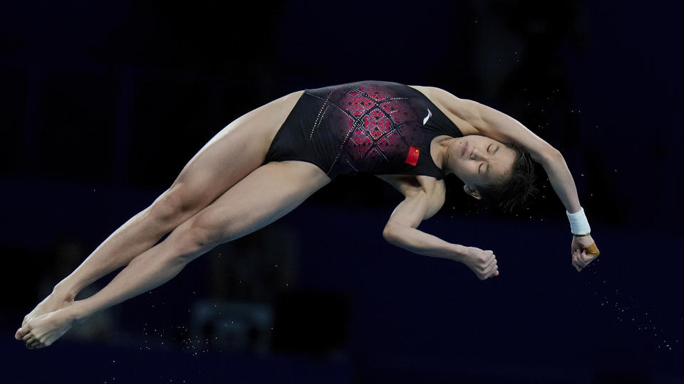 Quan Hongchan scored two perfect 10s while shattering an Olympic record. (AP Photo/Alessandra Tarantino)