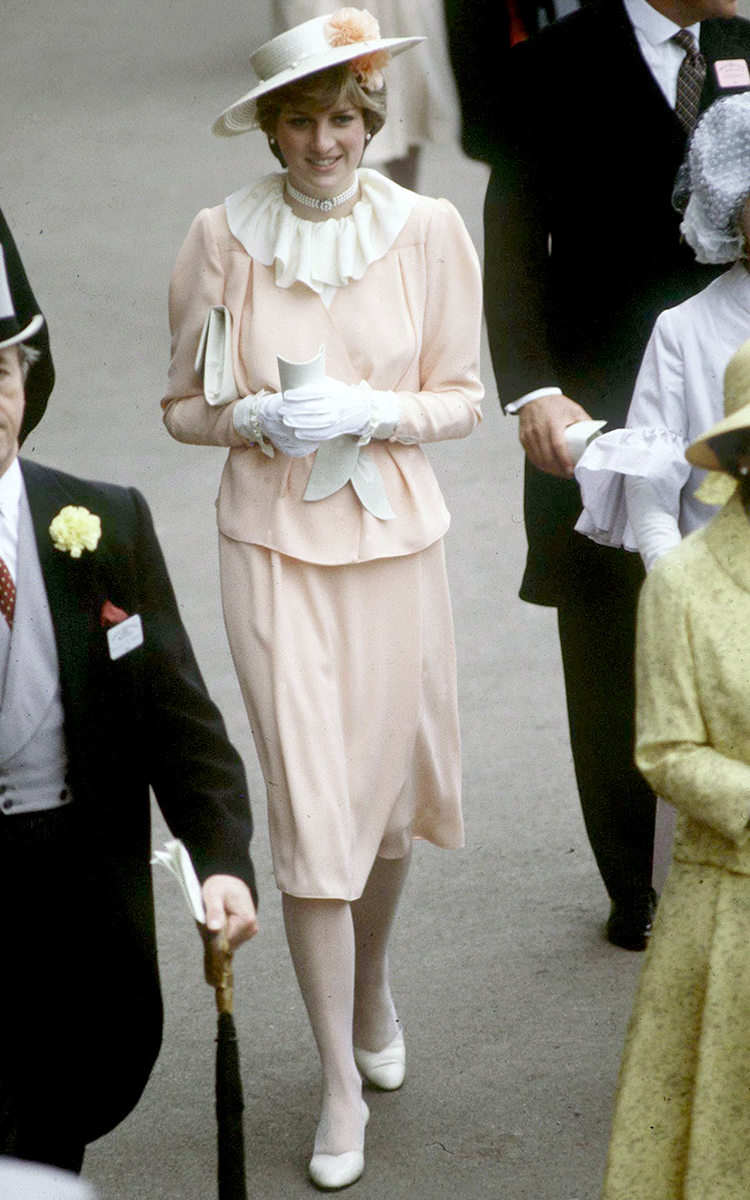 <p>Here's one of Di's first Royal Ascot outfits - a gloriously '80s peach number, with a frilly ivory collar, long gloves and an ornate hat.</p>