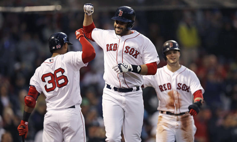 Remember when the Red Sox didn't have power last season? J.D. Martinez (center) certainly has changed that. (AP)