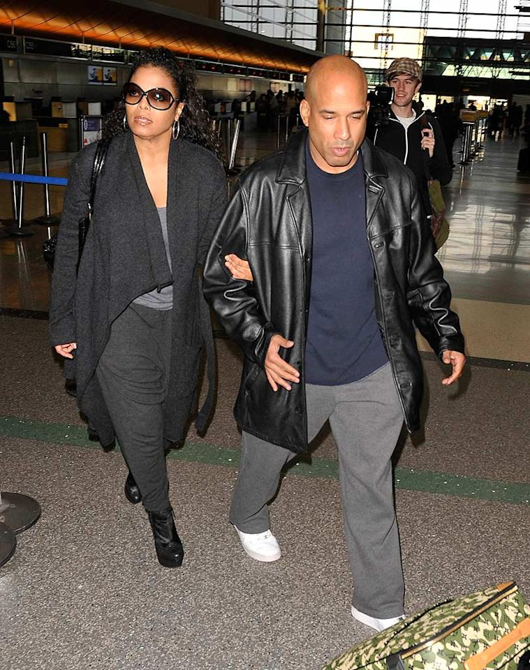 "Janet Jackson knows how to travel: with a bodyguard and an assistant to carry her camouflage Louis Vuitton luggage. Hot Shots Worldwide/<a href=""http://www.splashnewsonline.com"" target=""new"">Splash News</a> - December 2, 2009"