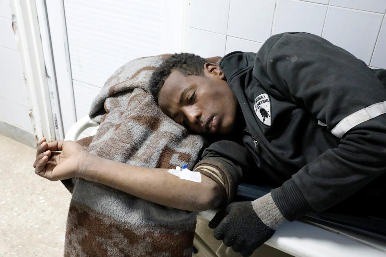 A migrant who was injured in a truck crash, lies on a bed at a hospital in Bani Walid town, Libya, February 14, 2018. REUTERS/Hani Amara