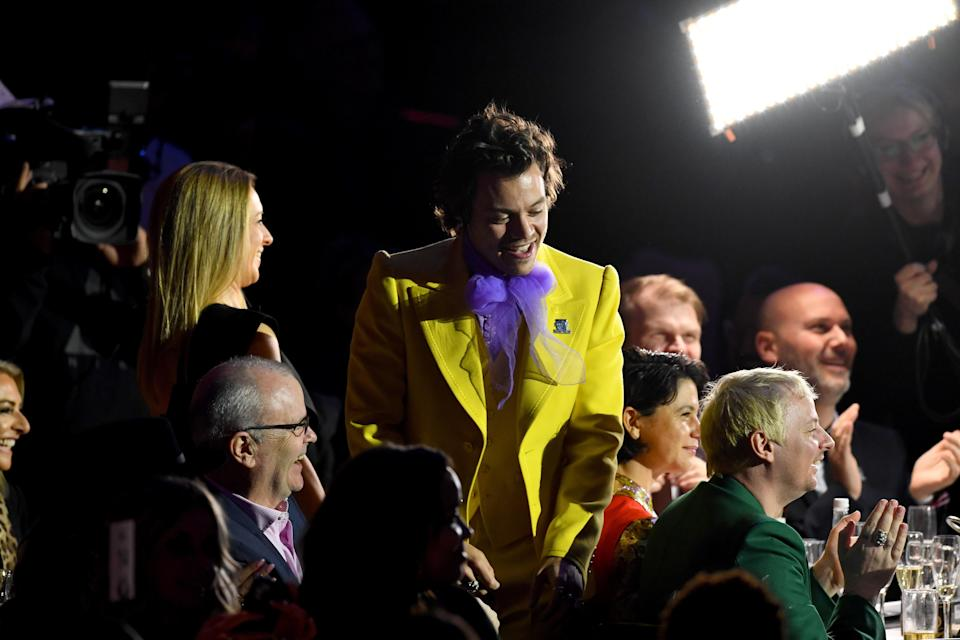 Then, he changed into a bright yellow suit with a far-from-subtle purple bow.