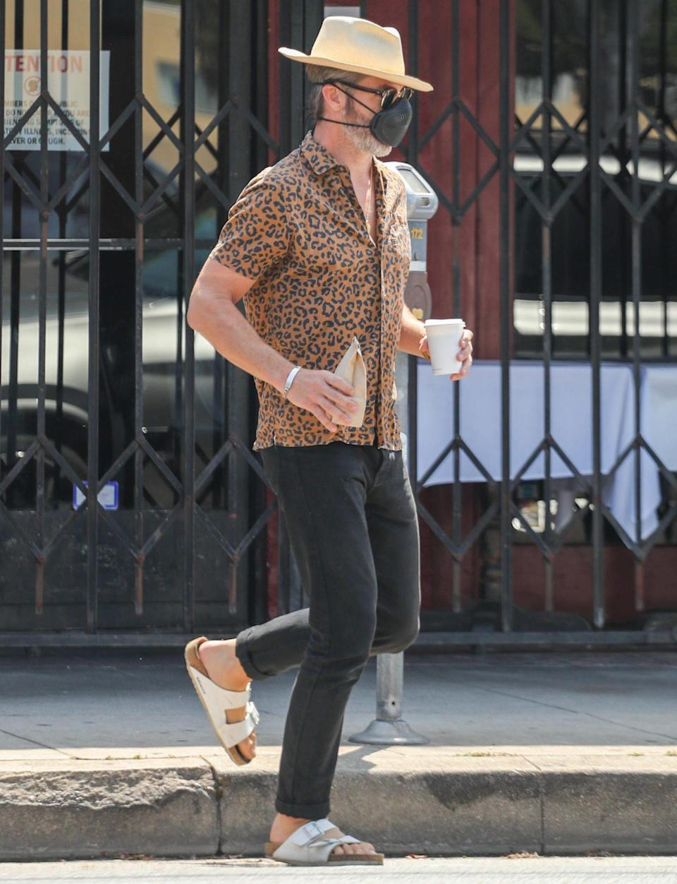 <p>Chris Pine wears a leopard print shirt to pick up coffee from Blue Bottle Coffee on Tuesday in L.A. </p>