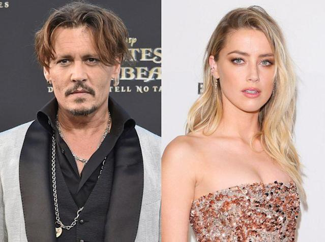 Reunited (by a lawsuit) — Johnny Depp and Amber Heard. (Photo: Getty Images)