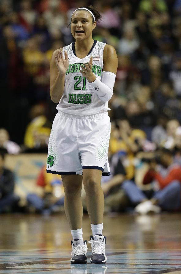 Notre Dame guard Kayla McBride (21) celebrates a goal against Maryland during the second half of the championship game in the Final Four of the NCAA women's college basketball tournament, Sunday, April 6, 2014, in Nashville, Tenn. (AP Photo/Mark Humphrey)