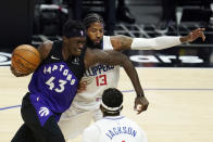 Toronto Raptors forward Pascal Siakam (43) is defended by Los Angeles Clippers guard Paul George (13) during the first half of an NBA basketball game Tuesday, May 4, 2021, in Los Angeles. (AP Photo/Marcio Jose Sanchez)
