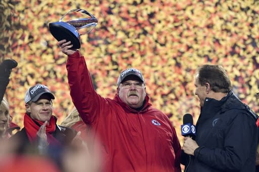 Kansas City Chiefs head coach Andy Reid holds the Lamar Hunt Trophy after the NFL AFC Championship football game against the Tennessee Titans Sunday, Jan. 19, 2020, in Kansas City, MO. The Chiefs won 35-24 to advance to Super Bowl 54. (AP Photo/Ed Zurga)