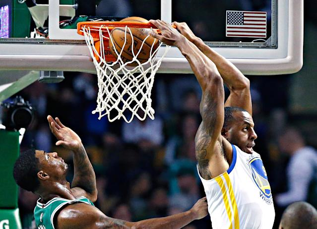 <p>Golden State Warriors' Andre Iguodala, second from right, does a reverse dunk in front of Boston Celtics' Marcus Smart, second from left, during the second quarter of an NBA basketball game in Boston, Thursday, Nov. 16, 2017. (AP Photo/Michael Dwyer) </p>