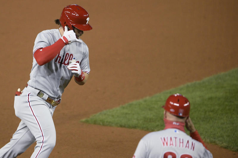 Harper's 2 HRs help Phils top Nats 12-3, push champs to edge