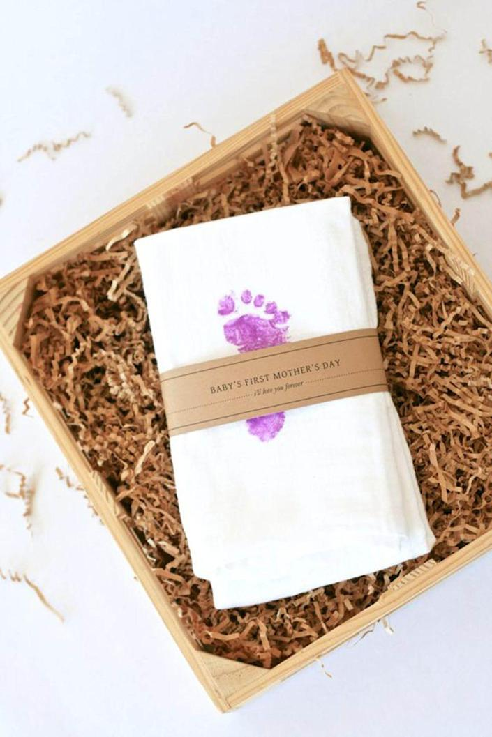 """<p>If your toddler recently became a big brother or sister, enlist his or her help to give Mom a precious keepsake of her <a href=""""https://www.countryliving.com/life/g4248/first-mothers-day-gifts/"""" rel=""""nofollow noopener"""" target=""""_blank"""" data-ylk=""""slk:first Mother's Day"""" class=""""link rapid-noclick-resp"""">first Mother's Day</a> with the new baby. Then go one step further and make another tea towel with the older kid's handprint.</p><p><strong>Get the tutorial at <a href=""""https://pagingsupermom.com/babys-first-mothers-day-gift-ideas//"""" rel=""""nofollow noopener"""" target=""""_blank"""" data-ylk=""""slk:Paging Supermom"""" class=""""link rapid-noclick-resp"""">Paging Supermom</a>.</strong></p><p><a class=""""link rapid-noclick-resp"""" href=""""https://www.amazon.com/KAF-Home-100-Percent-Absorbent-30-Inches/dp/B073R7V56K?tag=syn-yahoo-20&ascsubtag=%5Bartid%7C10050.g.19618668%5Bsrc%7Cyahoo-us"""" rel=""""nofollow noopener"""" target=""""_blank"""" data-ylk=""""slk:SHOP TEA TOWELS"""">SHOP TEA TOWELS </a></p>"""