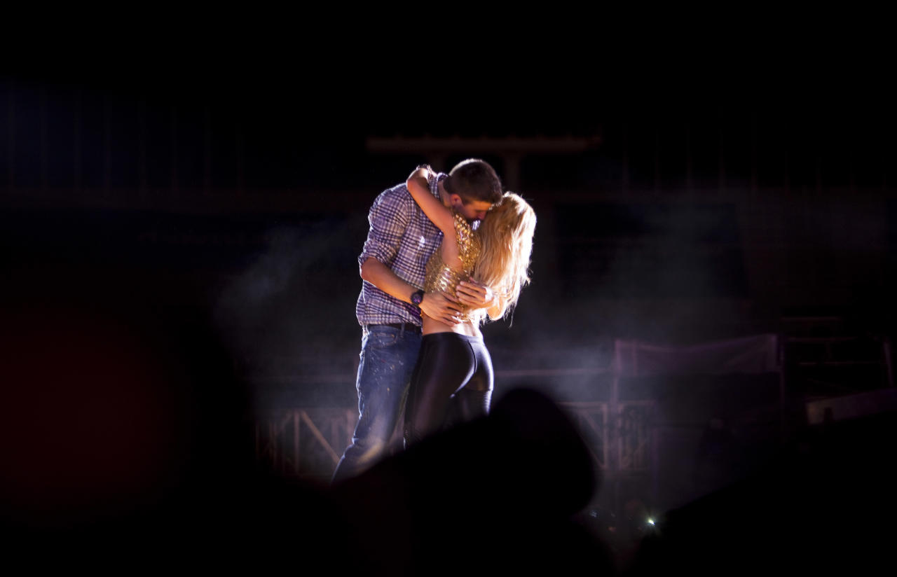 "Colombia's star singer Shakira performs with FC Barcelona's Gerard Pique during ""The Sun Comes Out World Tour"" concert in Barcelona, Spain, Sunday night, May 29, 2011."