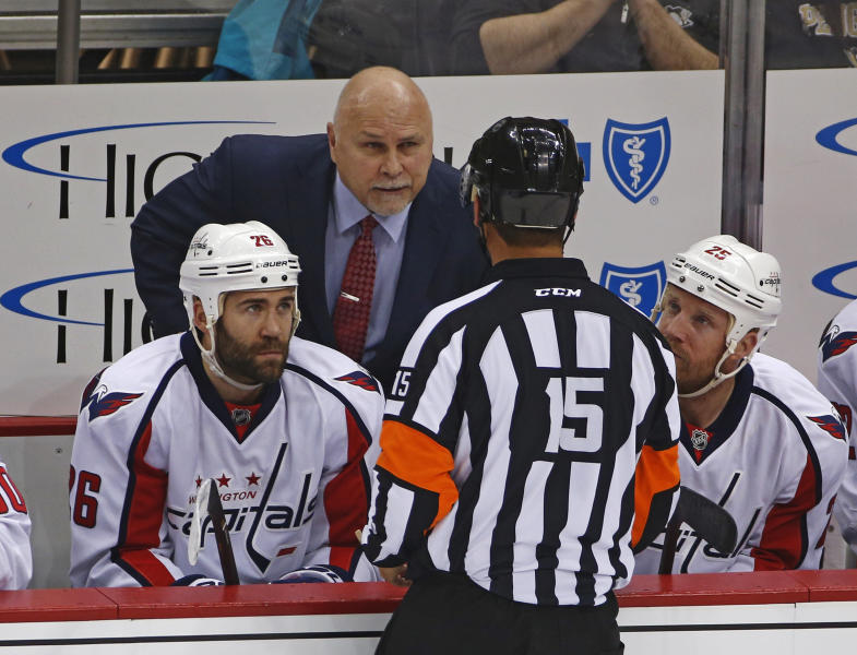 FILE - In this May 4, 2016, file photo, Washington Capitals head coach Barry Trotz talks to referee Jean Hebert, (15), during the first period of Game 4 against the Pittsburgh Penguins in an NHL hockey Stanley Cup Eastern Conference semifinals in Pittsburgh. NHL coaches will have more technology on the bench than ever before as the Stanley Cup playoffs begin. Three iPad Pros will be available for coaches on every bench and officials will also have them to review coach's challenges, The Associated Press has learned. (AP Photo/Gene J. Puskar, File)