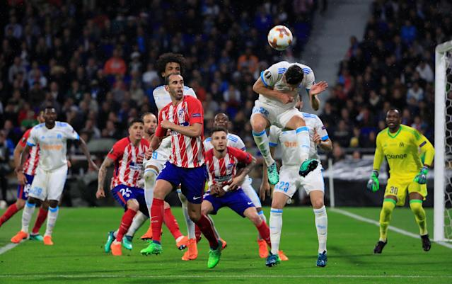 Soccer Football - Europa League Final - Olympique de Marseille vs Atletico Madrid - Groupama Stadium, Lyon, France - May 16, 2018 Marseille's Florian Thauvin in action with Atletico Madrid's Diego Godin REUTERS/Gonzalo Fuentes
