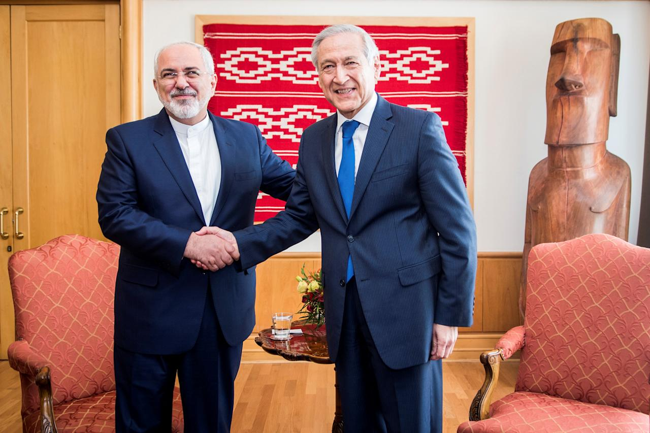 Iranian Foreign Minister Mohammad Javad Zarif (L) shakes hand with his Chilean counterpart Heraldo Munoz of Chile during a meeting at the Ministry of Foreign Affairs in Santiago, Chile, August 25, 2016. Viviana Urra/Courtesy of Chilean Ministry of Foreign Affairs/Handout via Reuters ATTENTION EDITORS - THIS IMAGE WAS PROVIDED BY A THIRD PARTY. EDITORIAL USE ONLY.