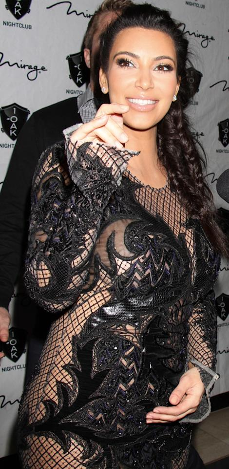 Mother-to-be Kim Kardashian and Kanye West ring in the New Year at 1 Oak Nightclub inside The Mirage in Las Vegas, NV. Pictured: Kim Kardashian Ref: SPL476277 010113 Picture by: London Entertainment / Splash News Splash News and Pictures Los Angeles: 310-821-2666 New York: 212-619-2666 London: 870-934-2666 photodesk@splashnews.com
