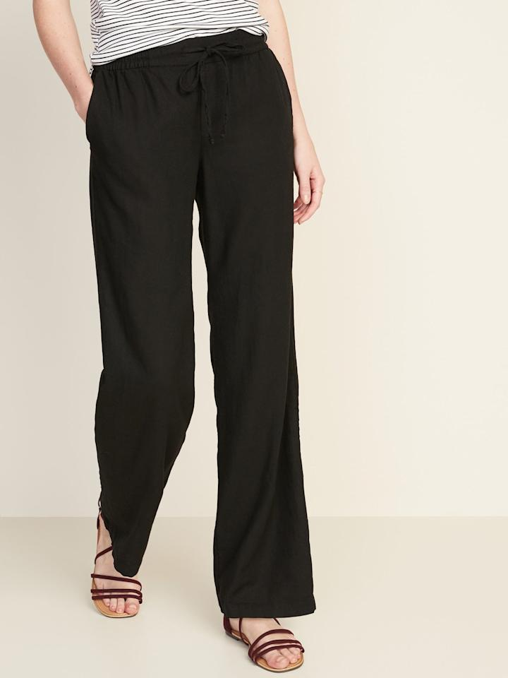 """<p>You can't go wrong with these <a href=""""https://www.popsugar.com/buy/Old-Navy-Mid-Rise-Wide-Leg-Linen-Blend-Pull--Pants-551921?p_name=Old%20Navy%20Mid-Rise%20Wide-Leg%20Linen-Blend%20Pull-On%20Pants&retailer=oldnavy.gap.com&pid=551921&price=35&evar1=fab%3Aus&evar9=47254489&evar98=https%3A%2F%2Fwww.popsugar.com%2Ffashion%2Fphoto-gallery%2F47254489%2Fimage%2F47256320%2FOld-Navy-Mid-Rise-Wide-Leg-Linen-Blend-Pull-On-Pants-in-Black-Jack&list1=old%20navy%2Cpants%2Ctravel%20style%2Cspring%20fashion%2Cfashion%20shopping&prop13=mobile&pdata=1"""" rel=""""nofollow"""" data-shoppable-link=""""1"""" target=""""_blank"""" class=""""ga-track"""" data-ga-category=""""Related"""" data-ga-label=""""https://oldnavy.gap.com/browse/product.do?pid=551156052&amp;cid=1061987&amp;pcid=5475&amp;vid=1&amp;grid=pds_135_314_1#pdp-page-content"""" data-ga-action=""""In-Line Links"""">Old Navy Mid-Rise Wide-Leg Linen-Blend Pull-On Pants</a> ($35, originally $40) in black.</p>"""