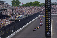 Fans fill the stands as Colton Herta leads the field in the early laps of the Indianapolis 500 auto race at Indianapolis Motor Speedway in Indianapolis, Sunday, May 30, 2021. About 135,000 spectators, about 40% of the speedway's capacity, were admitted to the track for the largest sports event since the start of the pandemic. (AP Photo/Paul Sancya)