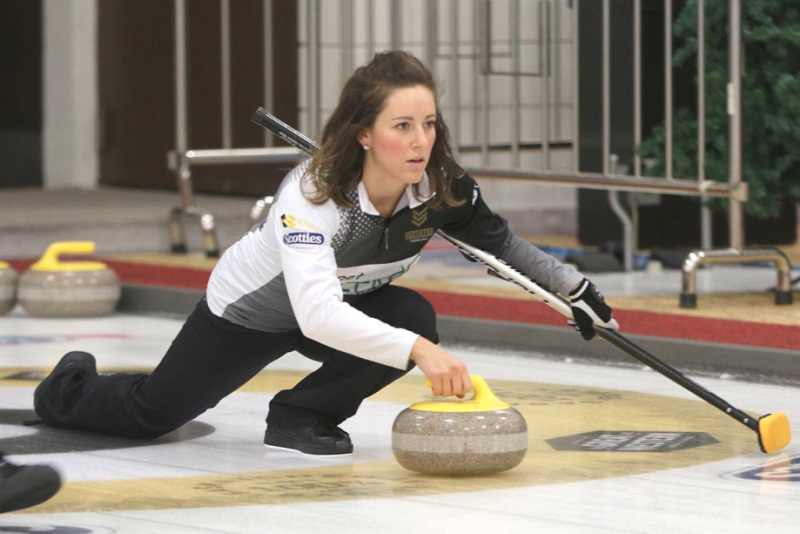 Picture of Aly Jenkins on the ice, during a curling competition, the sport which is popular in Canada.