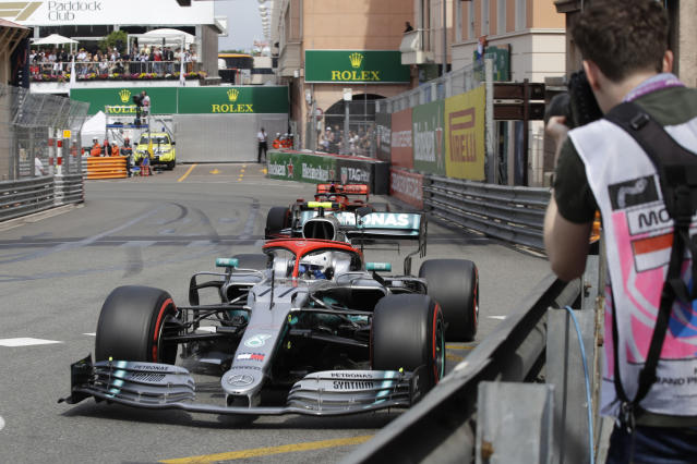 Mercedes driver Valtteri Bottas of Finland steers his car as followed by Ferrari driver Sebastian Vettel of Germany during the qualifying session at the Monaco racetrack, in Monaco, Saturday, May 25, 2019. The Formula one race will be held on Sunday. (AP Photo/Luca Bruno)
