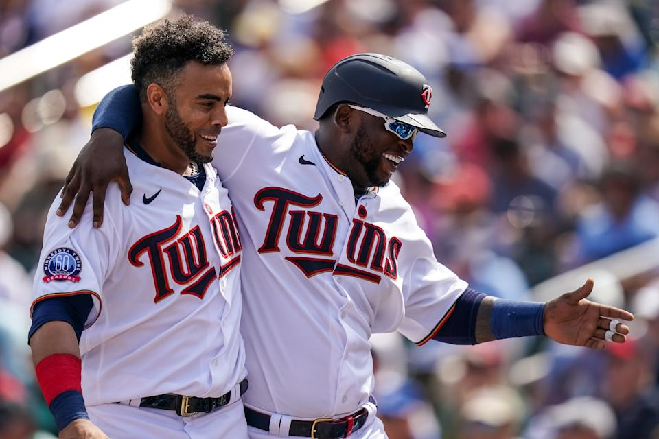 FORT MYERS, FL- MARCH 03: Miguel Sano #22 of the Minnesota Twins celebrates with Nelson Cruz #23 during a spring training game against the Detroit Tigers on March 3, 2020 at Hammond Stadium in Fort Myers, Florida. (Photo by Brace Hemmelgarn/Minnesota Twins/Getty Images)