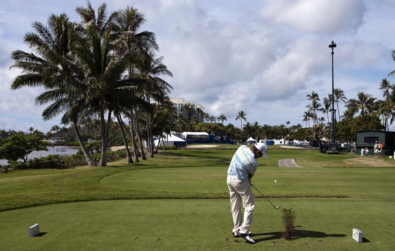 Erik Compton drives onto the 17th hole during the third round of the Sony Open golf tournament, Saturday, Jan. 14, 2012, in Honolulu. (AP Photo/Marco Garcia)