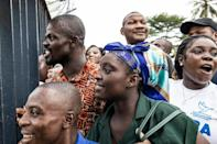 Joy: Gbagbo supporters react as his plane lands in Abidjan